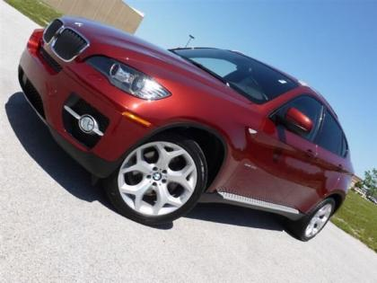 2011 BMW X6 XDRIVE35I - RED ON BEIGE